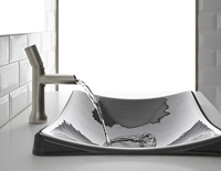 Silver decorative faucet running water into a grey decorative bathroom sink.
