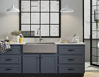 Built-in kitchen sink on top of a decorative kitchen cabinet & drawers with breakfast items on the counters to each side of the sink.